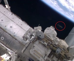 Possible UFO appears while astronauts are on a spacewalk at the ISS on October 7, 2014.